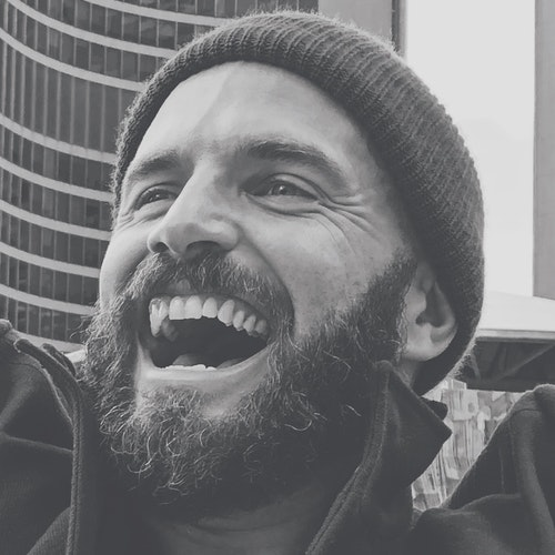 Me smiling with a beard
